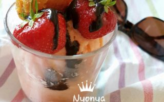 Melon yogurt Ice cream topped with strawberries, pineapple jam and chocolate shot sauce.