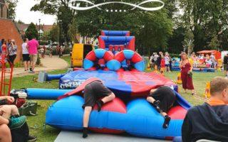 Hinckley feast, summer, holidays, kids having fun at bouncy castle.