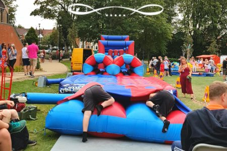 Hinckley feast, summer, holidays, kids having fun at bouncy castle.