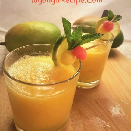 Mango smoothie tang yuan served in glasses, decorated with mint leaves, lime slices and pink and yellow balls.