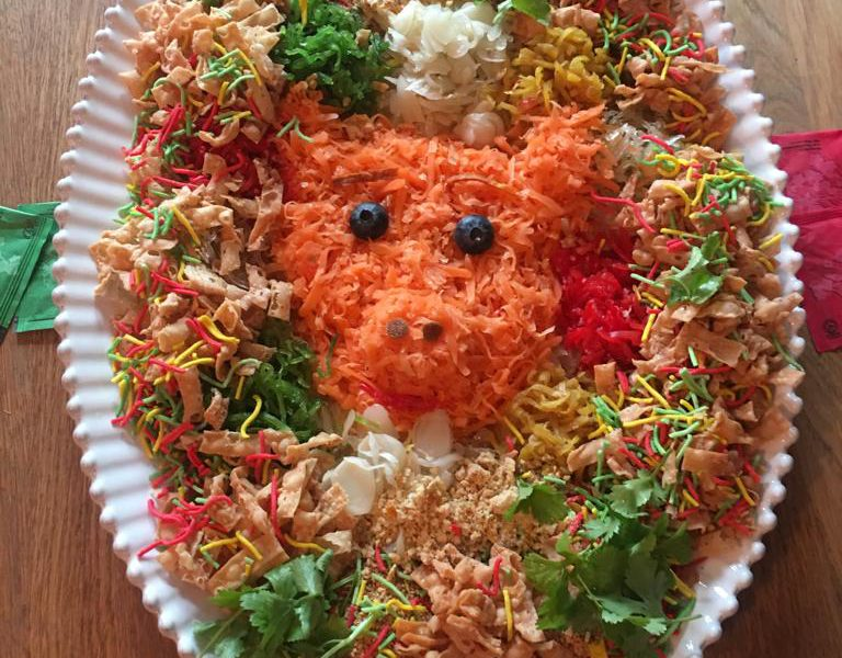 What is Chinese New Year Salad, pickled vegetables, prosperity salad to welcome the year, Salad decorated and arranged like a pig for the year of the pig,