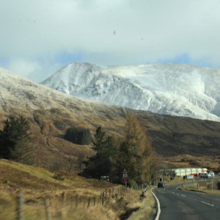 Scenery of Scotland from the car- snow-covered mountain.