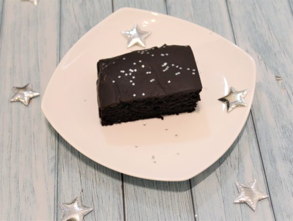 A slice of Chocolate cake with silver star decoration