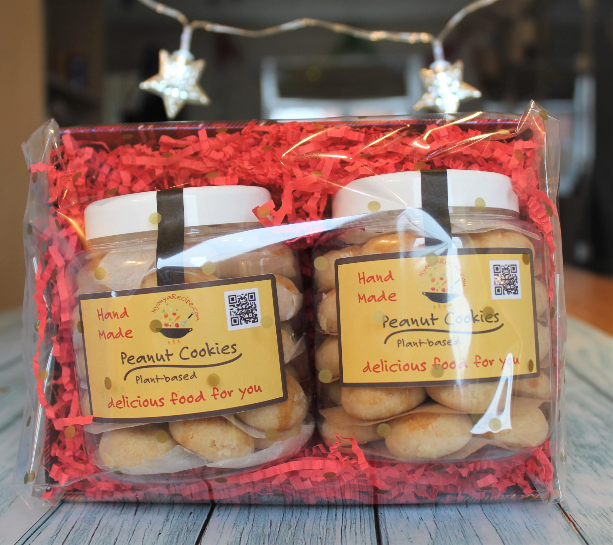 2 jars of plant-base peanut cookies packed as a gift.