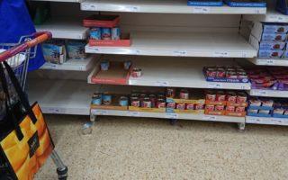 empty shelf in a super-market. No flour or essential food.