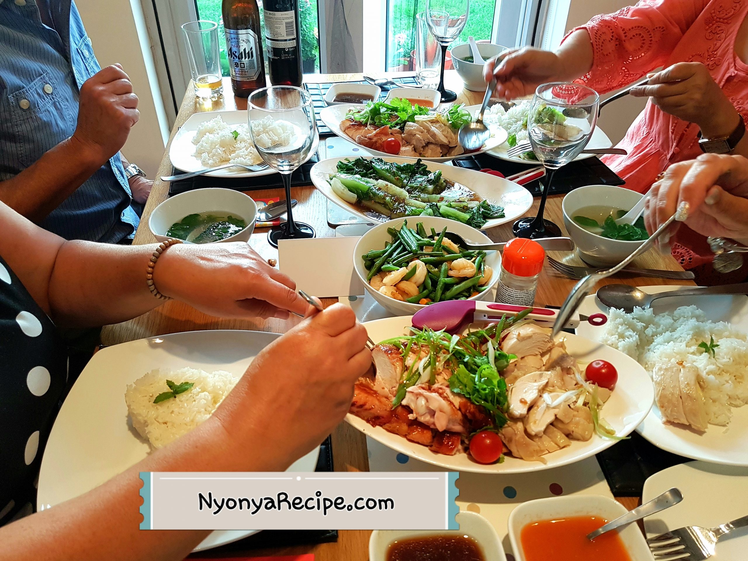 Diners enjoying Penang Hainanese Chicken Rice