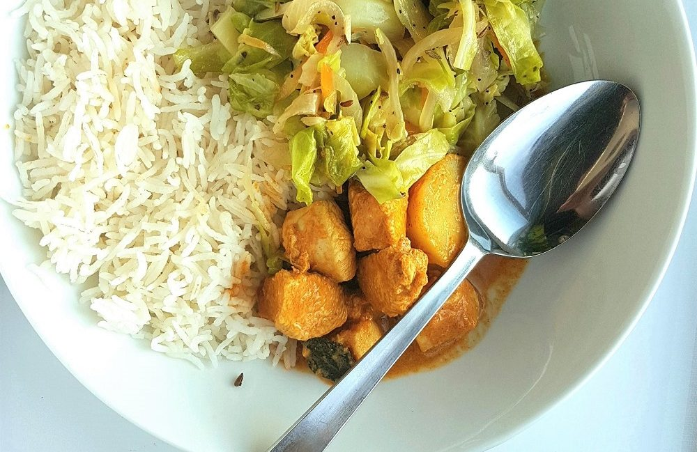 Nyonya Curry Bowl with rice and cabbage.