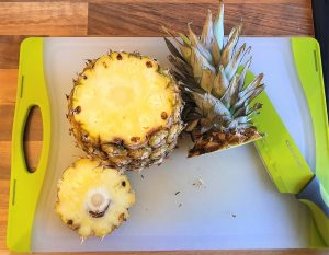Crown & base of pineapple cut off.