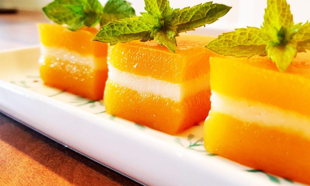 Golden orange coloured butternut squash kuih in a row.